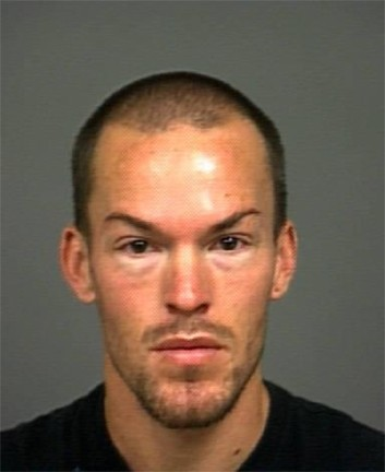 WILD NIGHT :  San Luis Obispo resident Samuel Dabill is accused in a string of vandalism and burglary events along a stretch of Marsh Street on Nov. 27, believed to have caused thousands of dollars in damage and scared the crap out of pedestrians and salon employees. - MUGSHOT COURTESY OF SLOPD