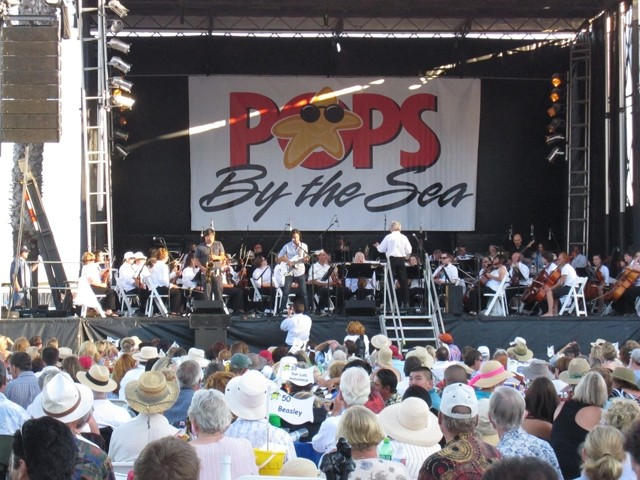 DIG THE SCENE! :  Pops by the Sea attendees can spring for VIP seating at chairs or tables, or bring a low backed chair or blanket and grab some grass. This shot is from a couple years ago when the Damon Castillo Band performed. - PHOTO COURTESY OF THE SLO SYMPHONY