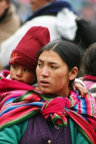 RED HEAD :  Photographer Janna Nichols shot this image of a woman and child on a 2005 trip to Huilloc, Peru. - PHOTO BY JANNA NICHOLS