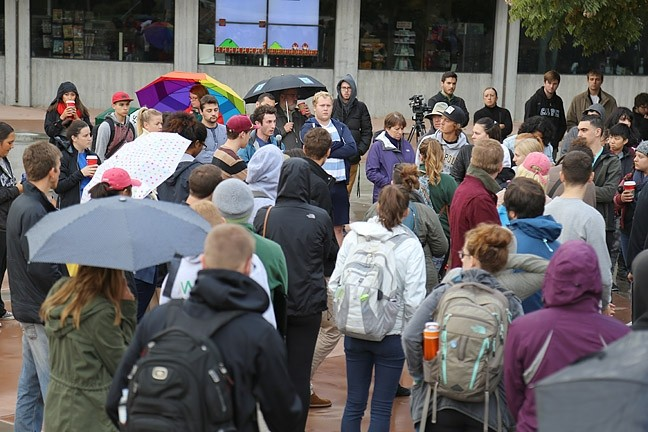 "STAND IN SOLIDARITY:  Cal Poly students congregated at University Union plaza on Nov. 15 to rally against offensive comments written on a ""free speech wall."" Students discussed the lack of diversity at Cal Poly and their experiences with discrimination and belonging on campus. - PHOTO BY DYLAN HONEA-BAUMANN"