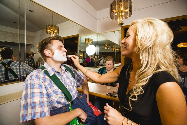 ALL DONE UP:  Emily, a sales rep for SunnyCountry radio in Santa Maria, kept Jono's attention while putting on his clown mask. - PHOTO BY HENRY BRUINGTON