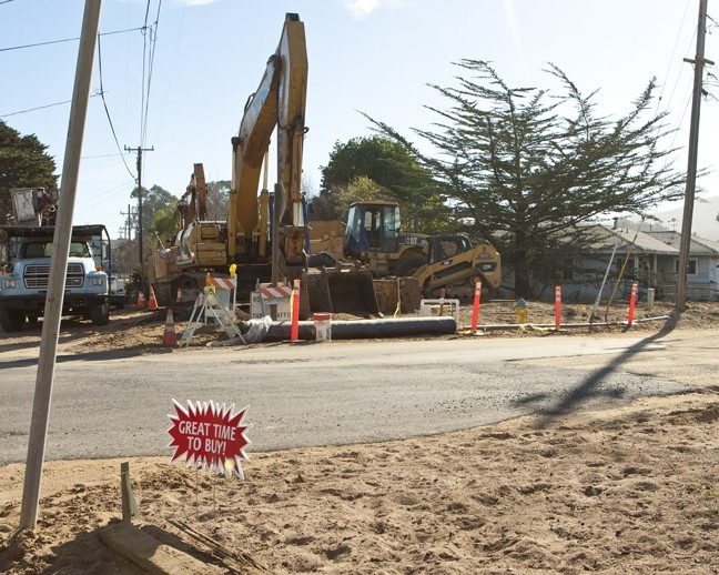 ALL TORE UP:  The San Luis Obispo County Board of Supervisors narrowly delayed the approval of more than $4 million in contract amendments for the Los Osos Wastewater project, which critics contend has run grossly over-budget and has led to significant inconveniences thanks to the ongoing road construction (pictured here at Fern Avenue). - PHOTO BY STEVE E. MILLER
