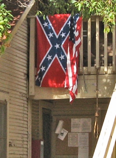 A CLOSER LOOK :  A hangman's noose can also be seen tied on a railing near the Confederate flag. Between them flies an American flag. - NEW TIMES STAFF PHOTO