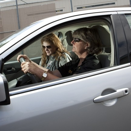MOBILE OFFICE :  Cathy Bianchi (driver) and Denise Braun spend a great - amount of time driving from location to location in the county to help various police agencies and the courts deal with people with mental health problems.