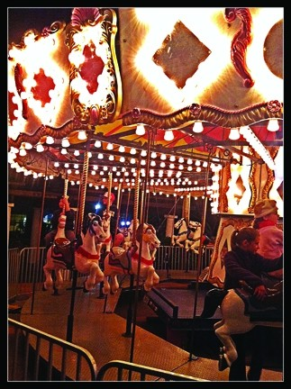 SPINNING 'ROUND! :  Take a classic carousel ride for $3 or buy four rides for $10. The carousel will stay up through Dec. 31.