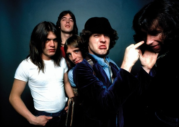 THE REAL MCCOY! :  Highway to Hell-era AC/DC members included Malcolm Young, Cliff Williams, Phil Rudd, Angus Young, and Bon Scott. - PHOTO COURTESY OF AC/DC