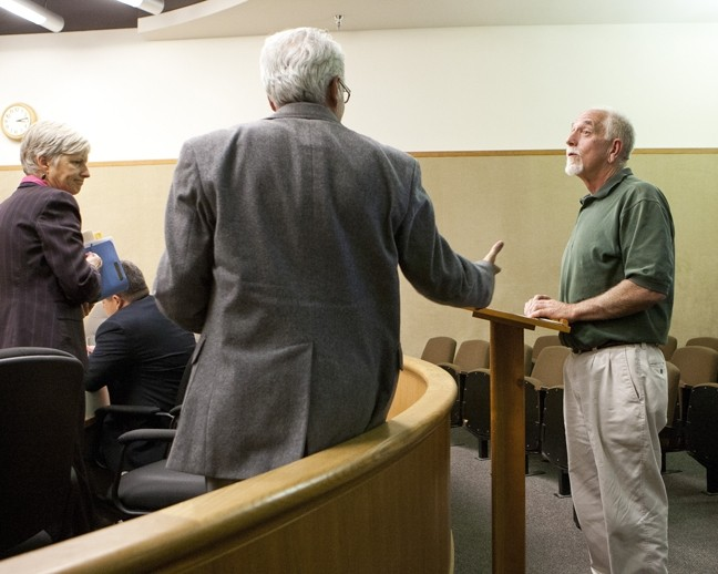 "OF OUR ELABORATE PLANS, THE END :  Peter Miller [right]—last of the so-called ""Doobie Dozen"" is offered a congratulatory handshake from his attorney, David Fisher, as Deputy District Attorney Sandy Mitchell [left] looks on. - PHOTO BY STEVE E. MILLER"