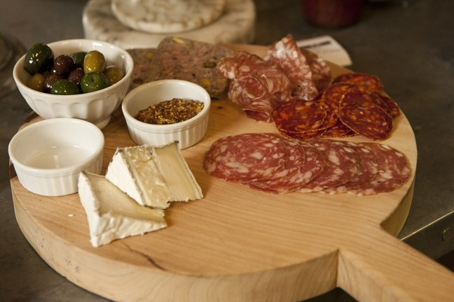 MEAT AND CHEESE :  Cutting boards covered in salami, cheese, and olives are one option for a light lunch.