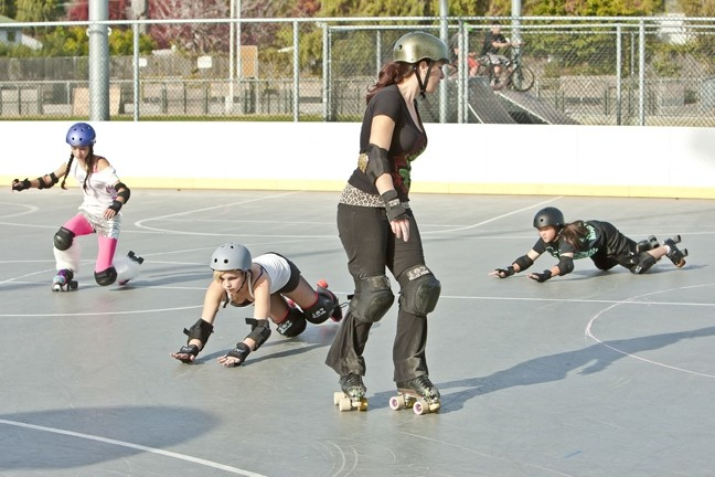 WONDER WOMEN:  Most of the participants in the junior derby league are still learning to skate, and fall. - PHOTO BY STEVE E. MILLER