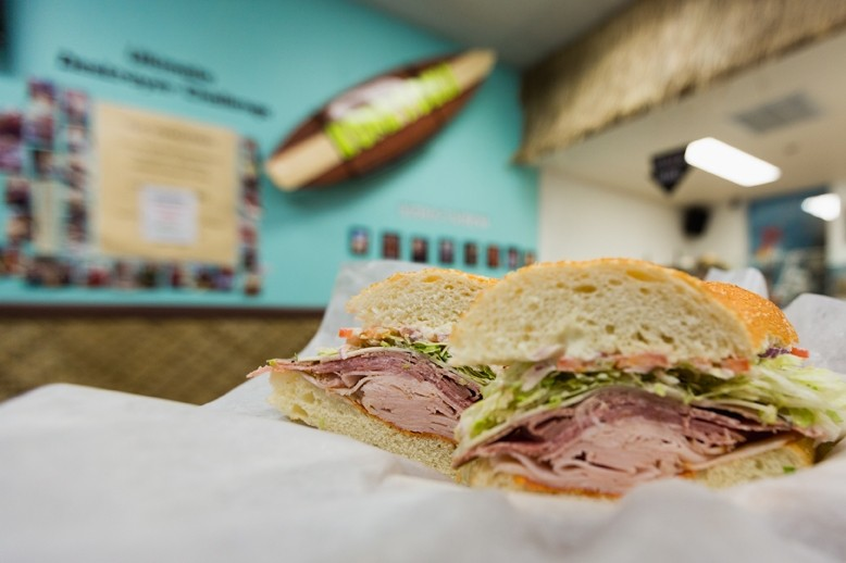 THE DESTROYER CHALLENGE IS ON:  Scarf two of these bad boys down in less than more 17 minutes and you could earn your photo on the Kona's Deli wall. Talk about bragging rights! - PHOTO BY KAORI FUNAHASHI