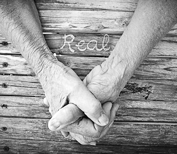 COVER OF REAL: - IMAGE COURTESY OF TERILEE DAWN OUIMETTE