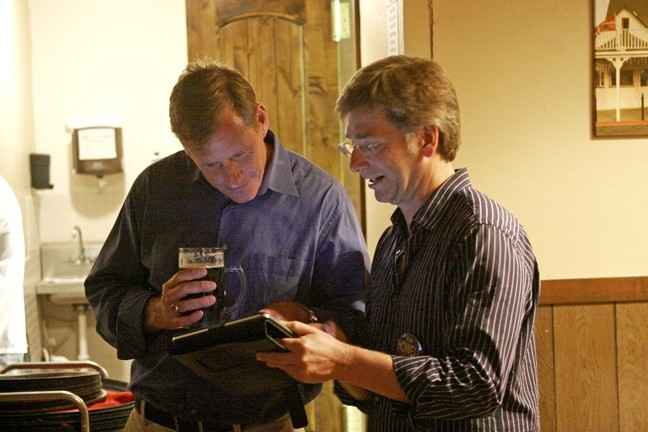 SCOPING THE GOOD NEWS :  Through the magic of technology, Eric Howell and his unofficial campaign assistant, Don Stewart, monitored Howell's winning bid for a seat on the Pismo Beach City Council. - PHOTO BY NICK POWELL