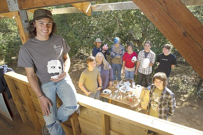 NATURE LEARNIN' :  (Left to right) Instructor Brian Engleton, Jack, instructor Susan Pendergast, Troy, Doran, Alexa, Grant, Royce, and Isaac create masks. - PHOTO BY STEVE E. MILLER