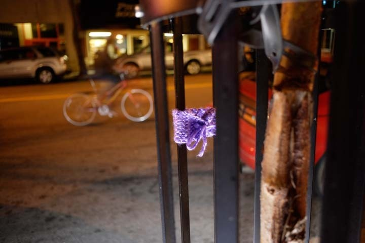 KNIT TAGGING :  A knit tag adds a spot of color to an otherwise normal street scene in downtown SLO. - PHOTO BY STEVE E. MILLER