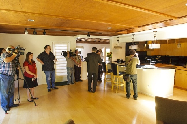 THE GRAND TOUR :  Cal Poly President Jeffrey Armstrong (center, back to the camera) shows local media what $337,000 in renovations looks like. - PHOTO BY STEVE E. MILLER