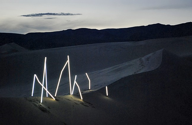 BRIGHT LIGHT:  Illume no. 1, a radiant photo collection crafted by SLO design duo Matt Shara and Kory Worl, is on display now at Kreuzberg through August. Pictured, the artists' bright installation glows against a Panamint Springs desert backdrop. - PHOTO COURTESY OF MATT SHARA AND KORY WORL