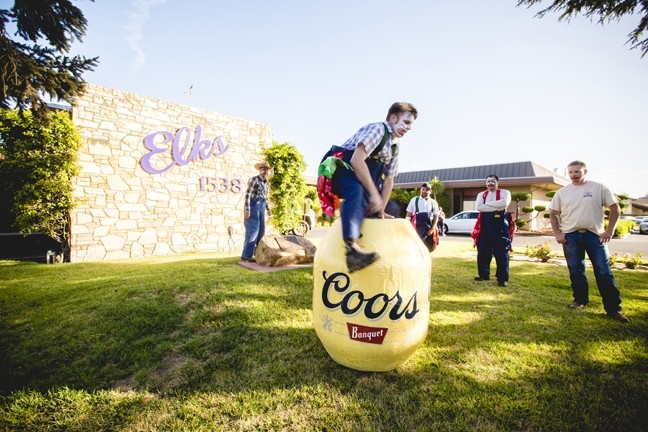 ROLL 'EM OUT:  During Rodeo Clown University, students got to (try to) hop into Professor Punkintown's own personal barrel, which he had custom made by a man in Idaho. - PHOTO BY HENRY BRUINGTON