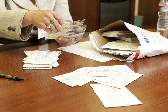 HELP US :  In attempt to dissuade SLO County supervisors from further cuts, CHC lobbied its patients to fill out postcards with personal stories. - PHOTO BY STEVE E. MILLER