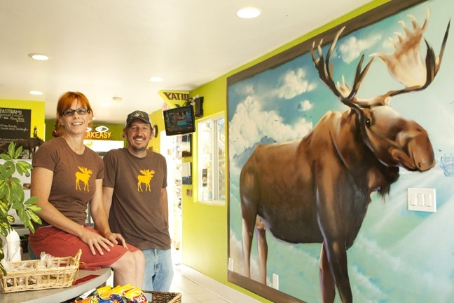 MEESES? :  Owners Amy Dillinger and Kevin Medici pose with a giant spraypainted moose mural created by Adam Moorhead of Southern California. - PHOTO BY STEVE E. MILLER