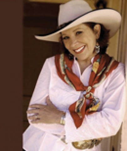 COLORFUL COWGAL :  Juni Fisher, Western Musics Female Vocalist of the Year, will play on April 25 in Paso Robles Divine Appointment Guitars. - PHOTO COURTESY OF JUNI FISHER