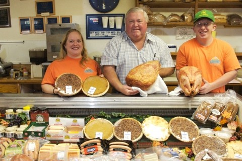ALL IN THE FAMILY :  Old Country Deli owner Norm Eggen (center) runs the business with his kids Elizabeth and William. They have a reputation for making some of the best smoked turkeys and hams in town.
