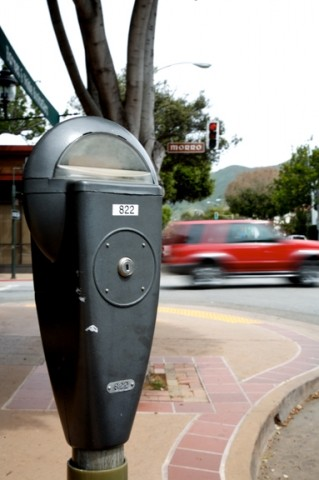 CHANGE, ANYONE? :  Engineers are shuffling a couple of San Luis Obispo city parking meters on downtown streets as workers increase the size of parking spaces. - PHOTO BY JESSE ACOSTA