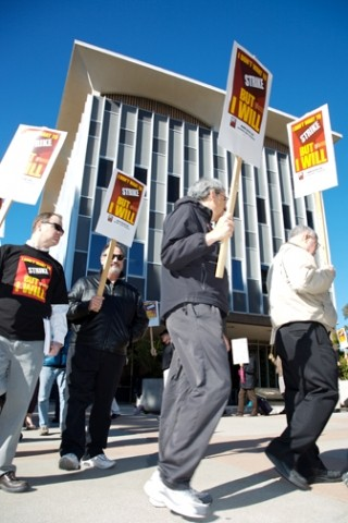 SIGNS OF THE TIMES :  Faculty members picketed the administration building at Cal Poly on Jan. 16. The event was part of a statewide move by the California State University Faculty Union throughout January to raise awareness of a bargaining impasse in contract negotiations with CSU administrators. - PHOTO BY JESSE ACOSTA