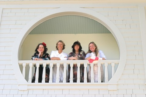 FOUR FLEW OVER THE CUCKOOS NEST Heidi Harmon, Suzi Kyle, Sonya Lea, and Tracy Taylor (left to right) survey the property and beckon guests from one of the historic houses many verandas. - CHRISTOPHER GARDNER