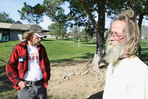 JUST VISITING :  Tony Day (left) and Michael F. Gaither (right) say that they've taken shelter in Meadow Park on rainy nights in the past, and they often hang out there during the day, but they don't camp there. - PHOTO BY STEVE E. MILLER