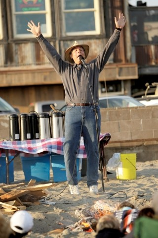 SPELLBINDING :  Storyteller Kirk Henning shares his stories with audiences at the Cayucos pier. - PHOTO BY STEVE E. MILLER