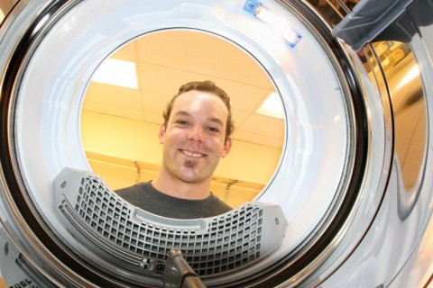 "MISTER CLEAN :  The future is bright and shiny for Nate Miller, owner of ""Fresh Threads� full service launderia. - PHOTO BY CHRISTOPHER GARDNER"