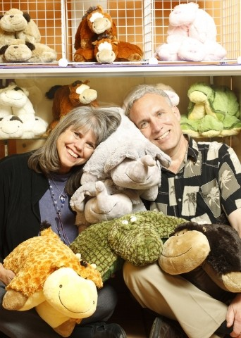 PETS YOU NEVER HAVE TO FEED :  Anita Halcyon (pictured with her husband, Dave Karpowicz) owns Anita's Pillow Pets, which sells functional stuffed animals. - PHOTO BY STEVE E. MILLER