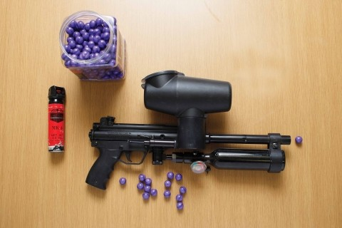 RED-EYE FIGHT :  Paintballs filled with pore-stinging Oleoresin Capsicum provide officers with an option besides batons or guns. - PHOTO BY STEVE E. MILLER