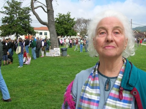 EXPERIENCED ACTIVIST :  Pat Miller, who claims founding membership in Mothers for Peace as part of her long history of activism, has seen a lot of protests and rallies over the years. The 80-year-old still tries to show up at events, but knows many fellow activists who can not because of age or fatigue. - PHOTO BY RYAN MILLER