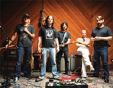 MELON HEADS UNITE :  Travis Warren (center), shown here with Blind Melon for whom he now sings, plays a solo acoustic set along with three other local frontmen, on April 17 at Downtown Brew as part of a new series: Grassroots Tuesdays. - PHOTO COURTESY OF BLIND MELON