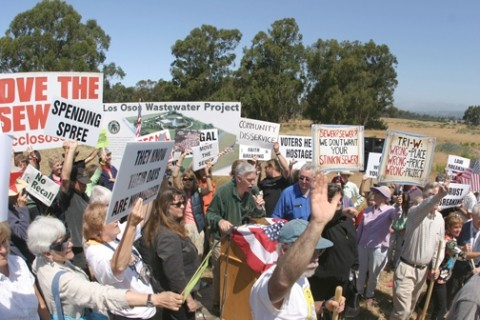 BROKEN GROUND :  Los Osos citizens protested when the pre-recall CSD board ceremonially broke ground at Tri-W. Now, an engineering firm puts that site at the bottom of the list for a sewer location. - FILE PHOTO