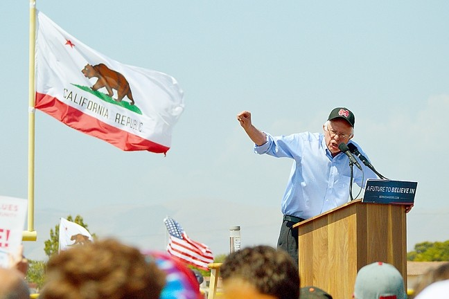 CALIFORNIA DREAMIN':  Democratic presidential candidate Sen. Bernie Sanders spoke to a packed crowd in Santa Maria. In the middle of his speech, he began feeling the burn coming on and put on a Santa Maria High School hat. - PHOTO BY JOE PAYNE