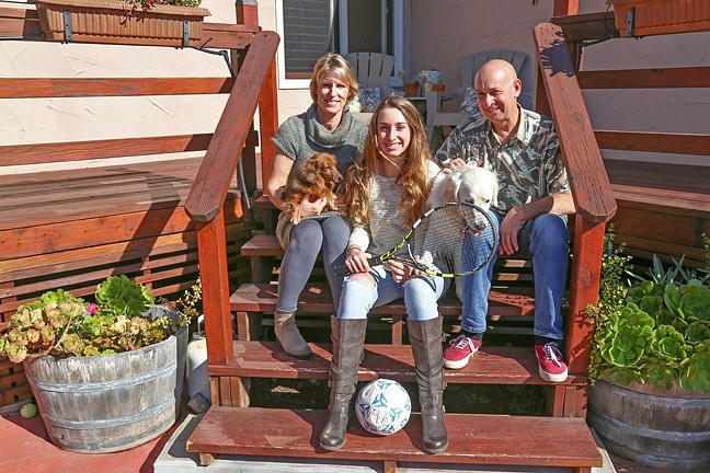 FAMILY ORDEAL :  Casey Lieberman (center), a 15-year-old soccer player from Arroyo Grande, suffered a severe concussion in a PE class last February that compromised her vestibular system. Casey experienced months of headaches, dizziness, sensitivity to light, and difficulty concentrating. Following her recovery, she quit soccer and now plays tennis. - PHOTO BY DYLAN HONEA-BAUMANN
