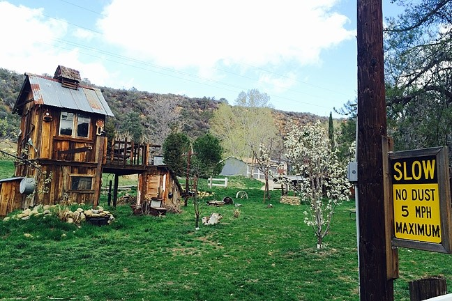 MINI G:  A fun-sized ghost town welcomes travelers to the Reyes Creek recreation area and the set of cabins also known as Scheideck. - PHOTO BY CAMILLIA LANHAM