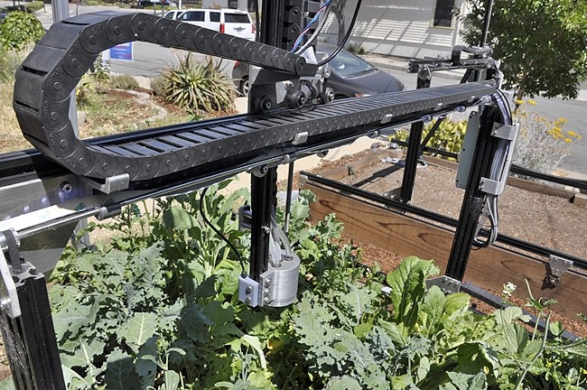 WATERBOT :  FarmBot irrigates individual plants in a raised garden bed. Version 10 will be available for pre-order starting on July 10 at farmbot.io. - PHOTO BY CAMILLIA LANHAM