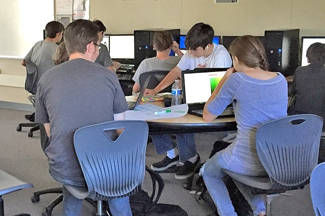 HACKING TO THE TOP :  Students from SLO work within a nine-hour period to turn their ideas into a final product. - PHOTO BY ALEXANDER DAVIDSON