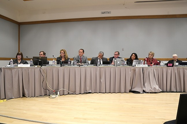 THE HOT SEAT:  Erik Howell (pictured fourth from the right), Pismo Beach City Council member and California coastal commissioner, has been under scrutiny since the Feb. 10 meeting where he was part of the voting majority to fire Executive Director Charles Lester. - PHOTO BY DYLAN HONEA-BAUMANN