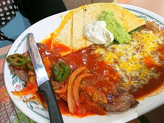 WOULD YOU LIKE YOUR STEAK 'WET?':  The massive Cazuelas steak dinner comes smothered in red sauce and is served with beans, warm tortillas, salad, and a gooey cheese quesadilla. - PHOTO BY REID CAIN