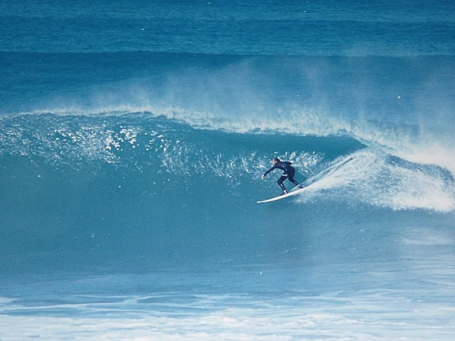 TOP TO BOTTOM:  Cass Holuk surfs at his favorite spot, Jeffreys Bay in South Africa, 1990. - PHOTO COURTESY OF CASS HOLUK