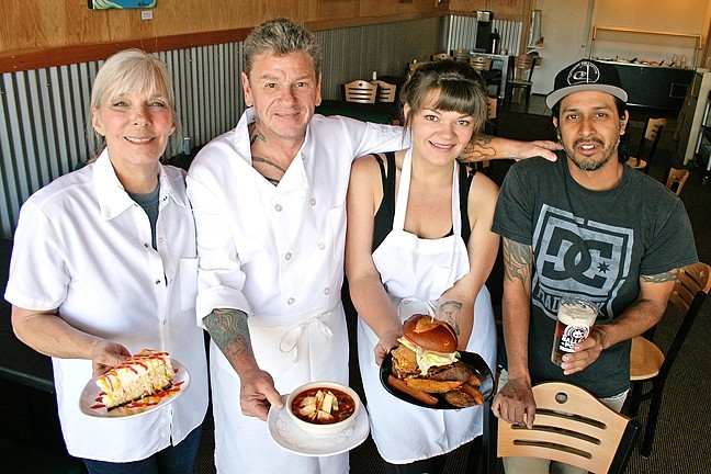 FACTORY WORKERS :  From left, Flavor Factory Chef/Owners Dawnelle and Adam Pollard, their daughter and cook Camille Pollard, and fellow employee David Ramirez. They're holding from-scratch mango cheesecake, tortilla soup, and a juicy burger, all of which have become staples of the new Morro Bay hangout. - PHOTO BY HAYLEY THOMAS