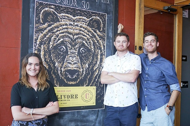 BRAND NEW:  (From left to right) Raleigh NeJame stands next to Calivore Spirits' Aaron Bergh and Luke Beaton, who launched a new line of locally-made rum at Sidecar in SLO on June 26. - PHOTO COURTESY OF CALIVORE SPIRITS