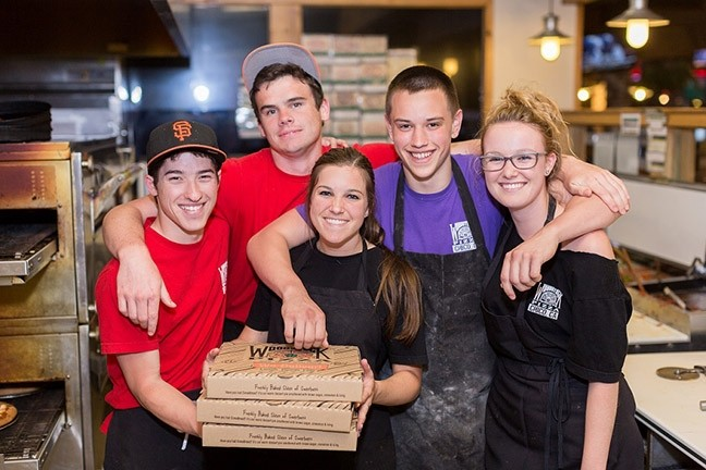 SLICE OF THE PIE:  Over the years, plenty of Woodstock's employees have gone on to do grand things. Case in point? SLO's current mayor, Heidi Harmon, was once a pizza tosser. - PHOTO COURTESY OF WOODSTOCKS PIZZA
