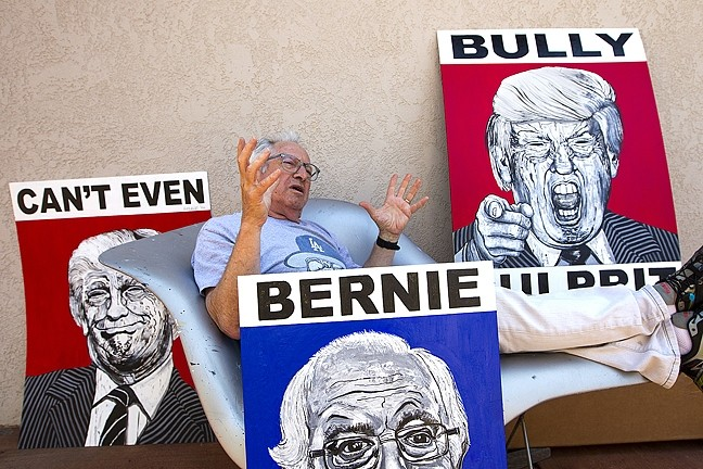 POSTER ARTIST:  Los Osos-based street artist Robbie Conal hangs out with his Donald Trump and Bernie Sanders paintings. The Trump ones are also available in poster form. - PHOTO BY JAYSON MELLOM