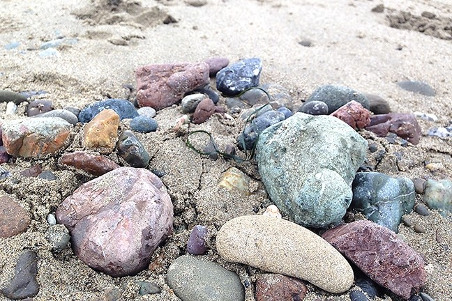 ROCK SPLENDOR:  The beaches are chock-full of colorful rocks right now. It's a blast to admire them—and pick out the good skipping rocks! - PHOTO BY PETER JOHNSON