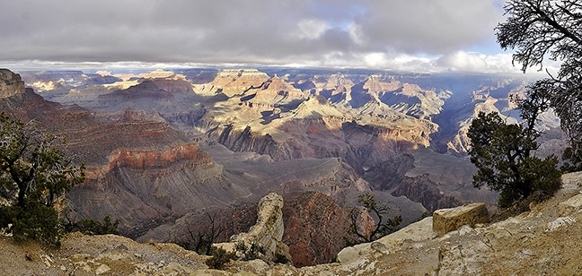 UNFATHOMABLE:  Millions of years of history are encased in the layers of exposed rock that are visible from the South Rim of the Grand Canyon. A rare break in the clouds shed light on the Colorado River, 4,000 feet below, on Dec. 24, 2016. - PHOTO BY CAMILLIA LANHAM
